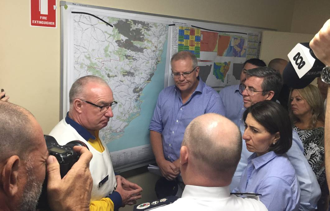 GRIM TIMES: RFS Incident controller Kam Baker briefing Prime Minister Scott Morrison, Lyne MP Dr David Gillespie, State Premier Gladys Berejiklian and Port Macquarie-Hastings Mayor Peta Pinson. Photo: Peter Daniels.