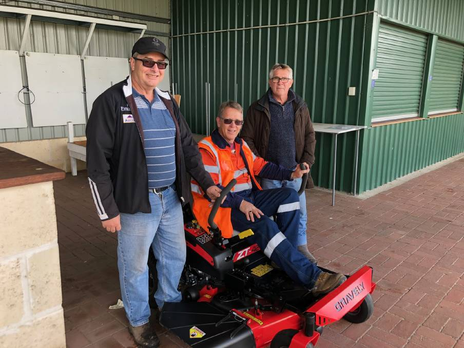 New beginnings: Collie Race Club members Robert Pimm (left) and John Lincoln (right) with Premier Coal training advisor Steve Plaskett on the new mower. Photo: Supplied.