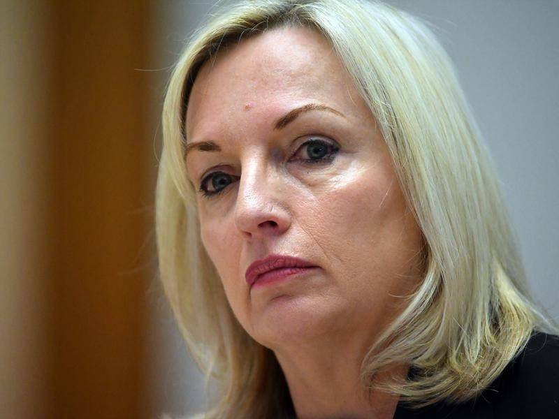 Australia Post chief Christine Holgate has been asked to stand aside over luxury watch purchases.